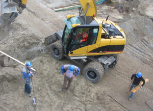 Workers standing around a crane
