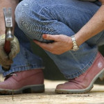 Lady in brown boots with hammer